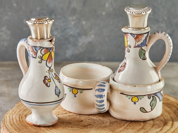 Antique crockery, two ceramic decanters for wine.