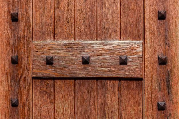 Antique door antique wooden door of the church close up
