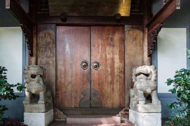 Antique door knocker shaped like a lion's head.
