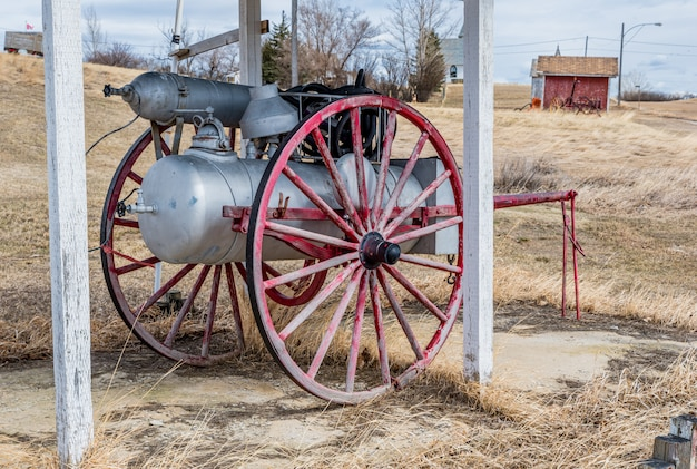 Antique fire fighting equipment on a wooden carriage