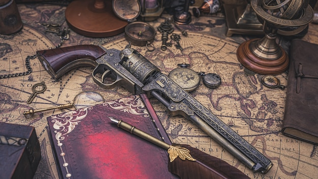 Antique firearm gun on old map