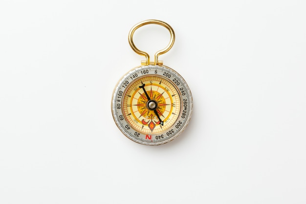 Antique golden compass isolated