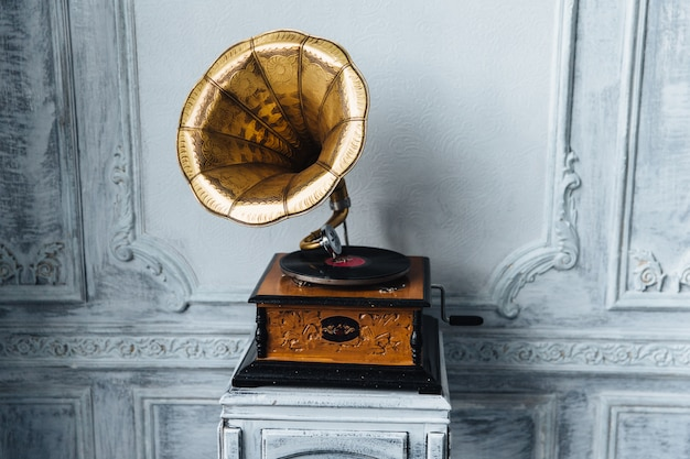 Antique gramophone with retro plate produces pleasant sounds or music