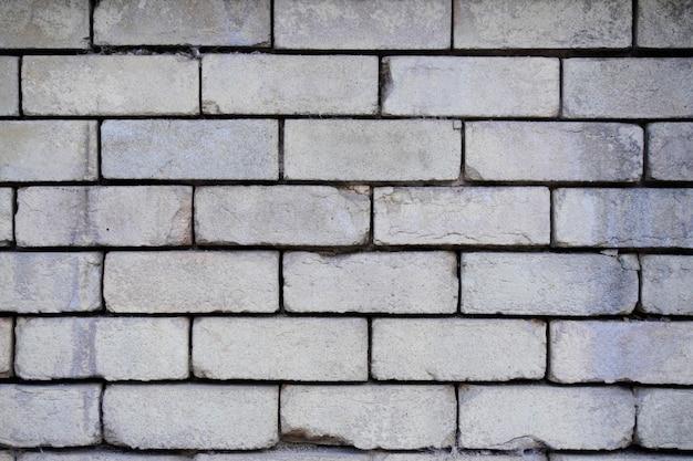골동품 회색 벽돌 벽 텍스처