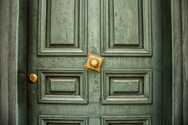 Antique green door with golden handle