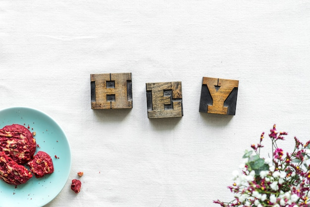 Antique grunge letter cube spelling hey greeting concept