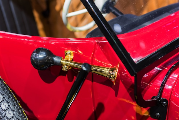 Antique horn of a red vintage car