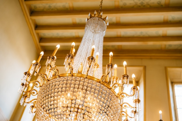 Antique large crystal chandelier with pendants and candles