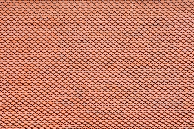 Antique orange tile roof pattern at the buddha temple in thailand