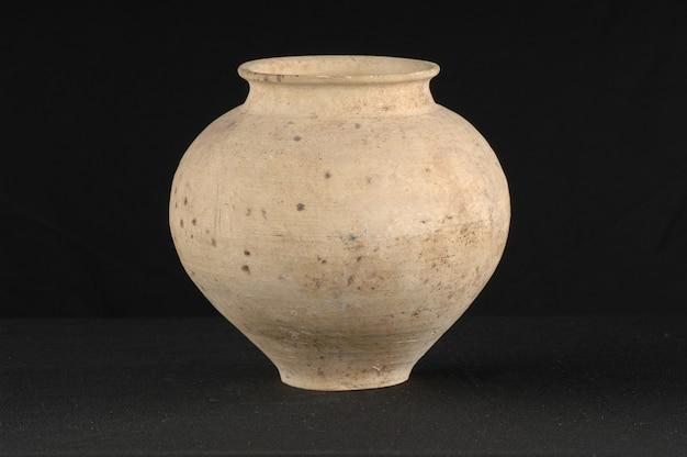 Antique oriental pot ceramic on a black background closeup