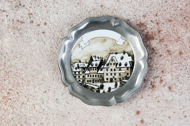 Antique pewter coaster, small dish on concrete