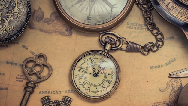 Antique pocket watch on map