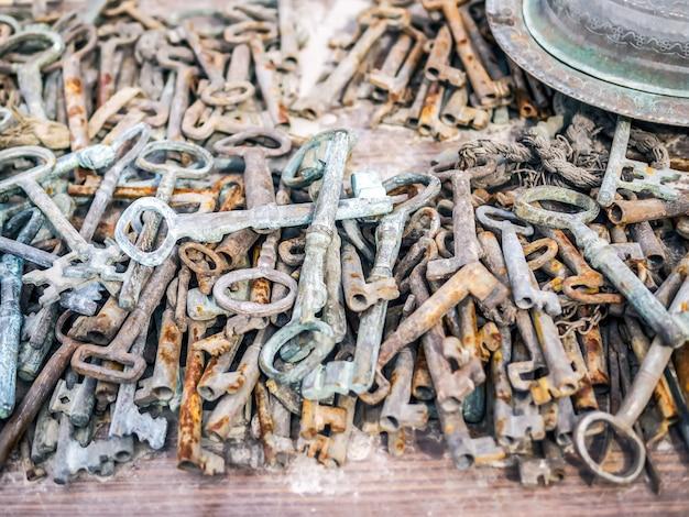 Antique rusty metal keys on a market stall at a flee market
