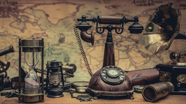 Antique telephone and hourglass