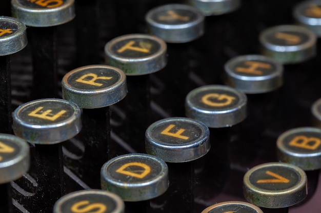 Antique typewriter keys closeup photo - vintage old typewriter machine detail