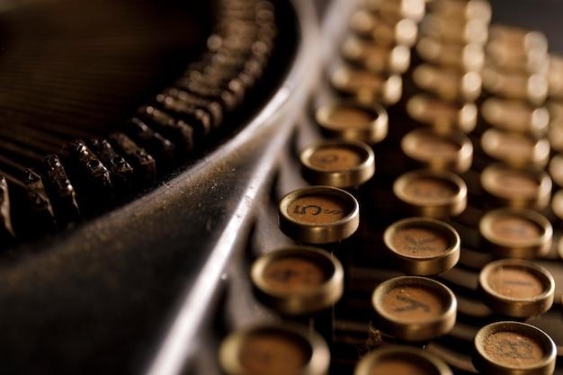 Antique typewriter. vintage typewriter machine closeup photo.