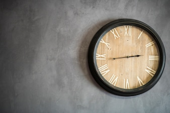 Antique Wall clock on concrete wall