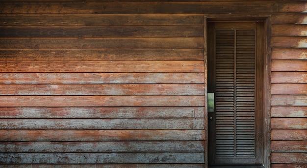 Античная деревянная стена и дверь архитектура фон