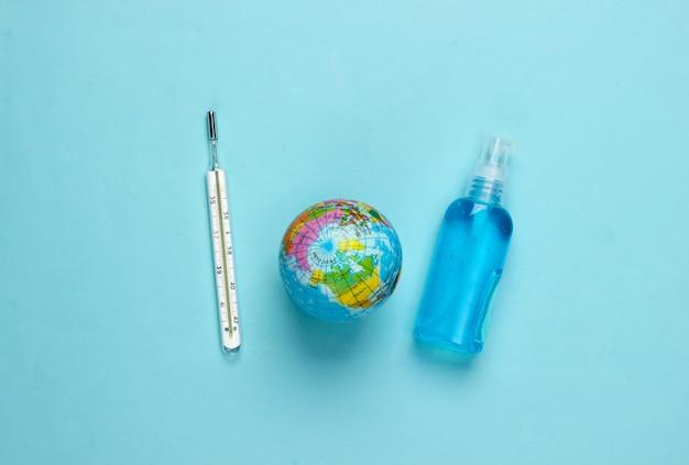 방부제 병, 온도계 및 파랑에 지구본