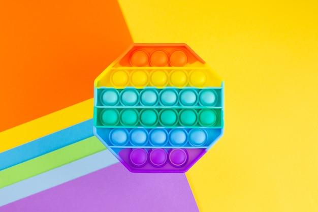Игрушка-антистресс pop it rainbow, силиконовая сенсорная непоседа на красочном фоне