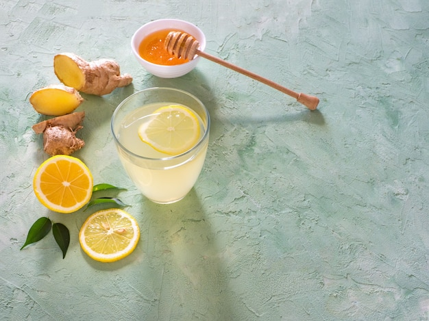 Antiviral drink with lemon, honey and ginger root, strengthening of immunity concept, horizontal with copy space