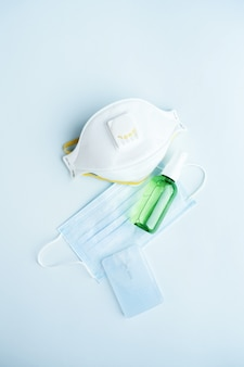 Antivirus set of items: various filtering safety face masks, sanitizer for hands.