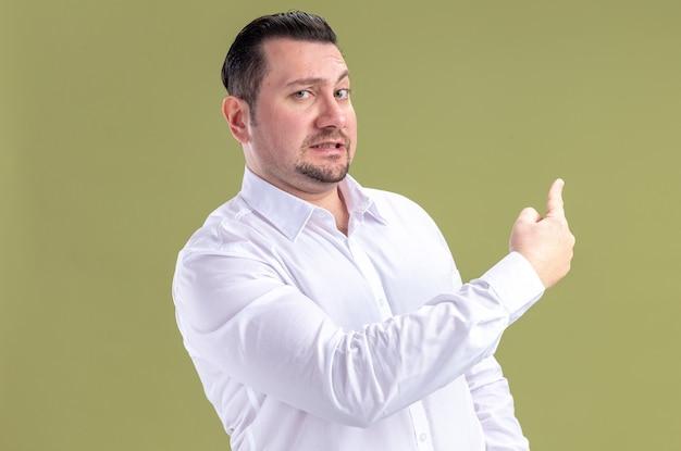 Anxious adult slavic businessman pointing back