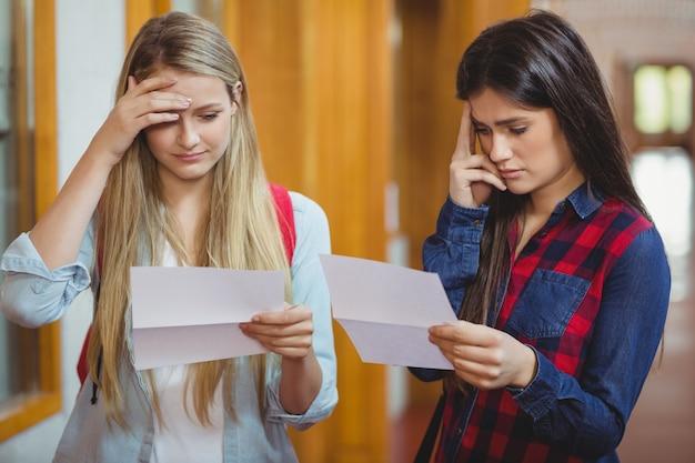 Anxious students looking at results at university