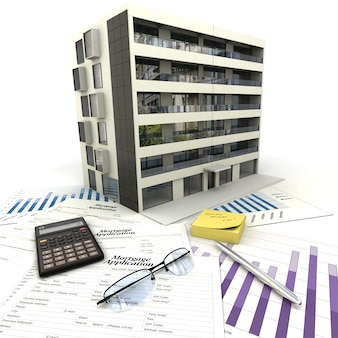 Apartment building on top of a table with mortgage application form, calculator, blueprints, etc..