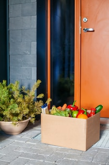 Apartment entrance with delivered box with food. contactless delivery.