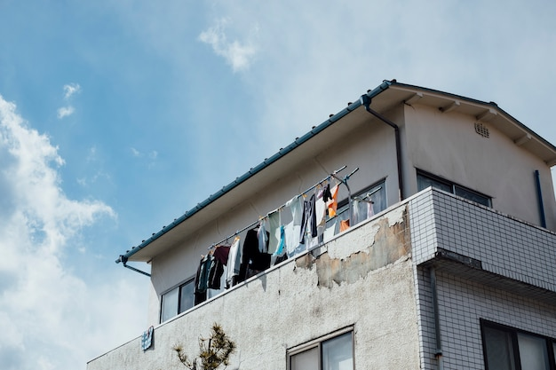 Apartment hanging washed clothes in japan