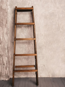 Apartment renovation. wooden ladder in empty room