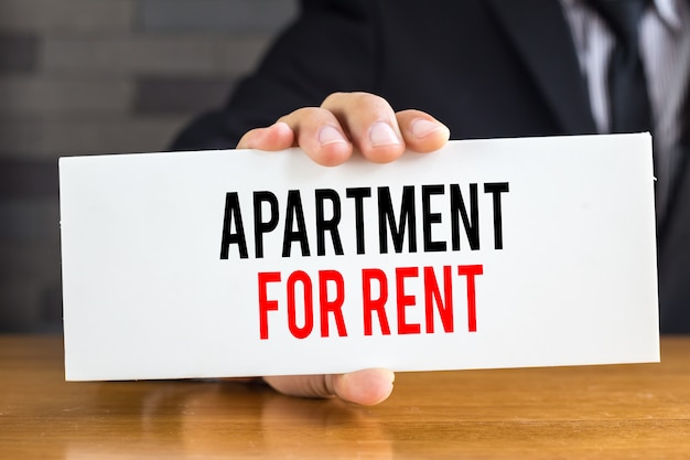 Apartment for rent message on white board