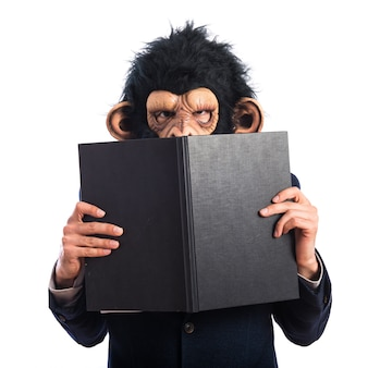 Ape man hiding behind a book