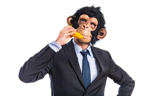 Ape man speaking through a banana