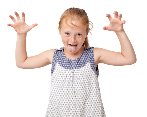 Aping ginger girl making scaring gesture