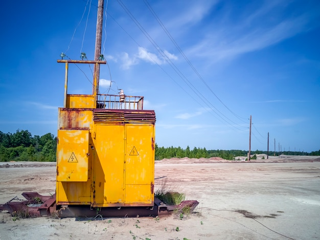 Apocalyptic landscape. abandoned electric transformer station among on cracked and scorched land. solidified white earth surface. a planet without people. global warming concept.