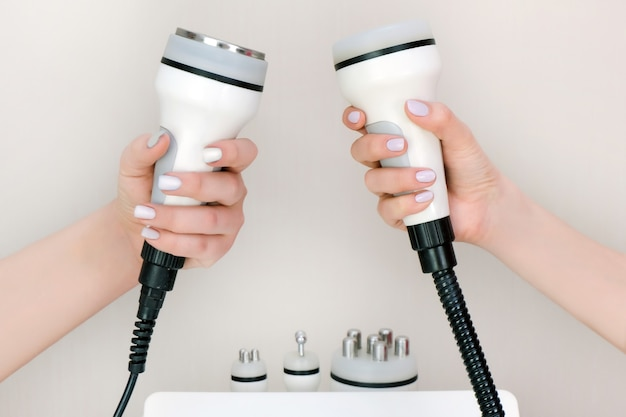 Apparatus massager in the hand of a beautician. rf lifting, ultrasound, vacuum