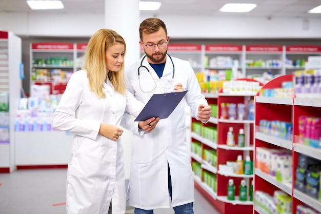 Appealing two caucasian pharmacists communicating