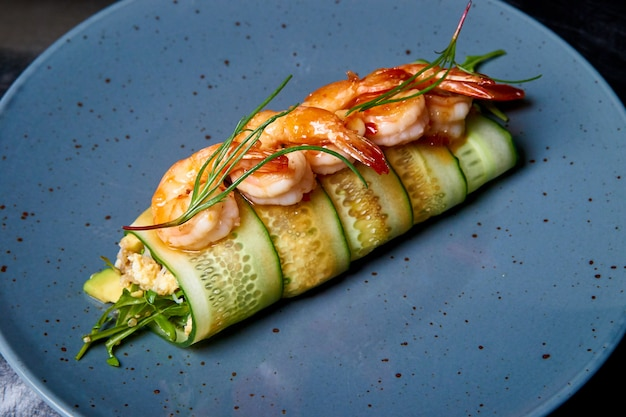 Appetizer of cucumber rolls with shrimp and cream cheese.