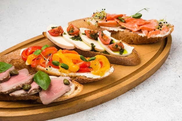 Appetizer different sandwiches with red fish, veal and cheese
