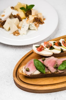 Appetizer different sandwiches with  veal and cheese