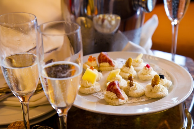 Appetizer plate with champagne glass