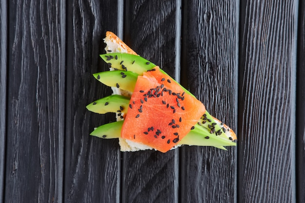 Appetizer for reception. sandwich with smoked salmon, ricotta snd avocado