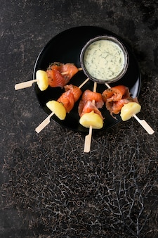 Appetizer with smoked salmon and potatoes