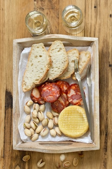 Appetizer on wooden tray