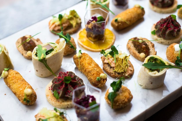 Appetizers table with different antipasti snacks