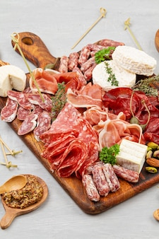 Appetizers table with differents antipasti, charcuterie, snacks and wine
