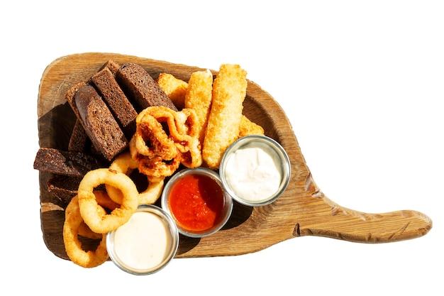 Appetizing beer snacks on a wooden board