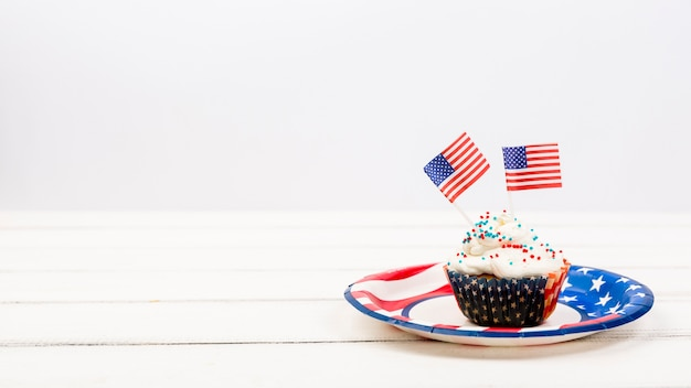Appetizing cupcake on plate with american flags